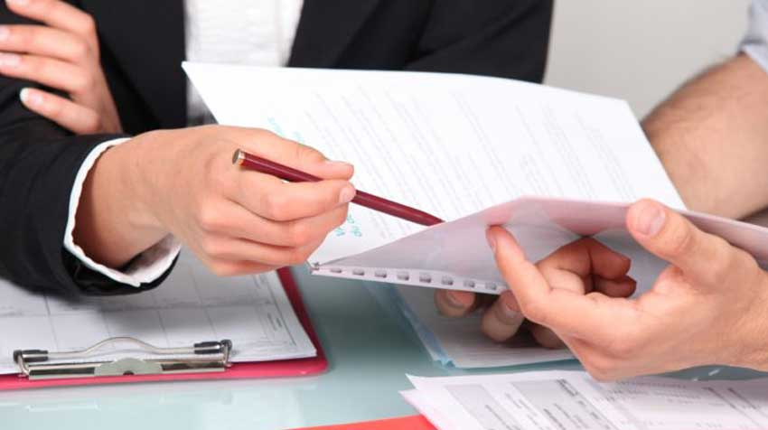 A couple goes over documents.
